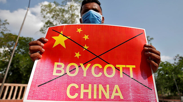FILE PHOTO: A member of National Students' Union of India (NSUI) holds a placard during a protest against China, in Ahmedabad, India, June 18, 2020. REUTERS/Amit Dave/File Photo