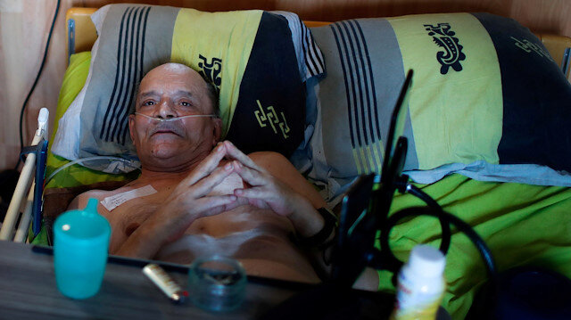 Alain Cocq, 57, in his medical bed he has been confined to for years as a result of a degenerative disease that has no treatment, poses after an interview with Reuters at his home in Dijon, France, August 19, 2020. Picture taken on August 19, 2020.