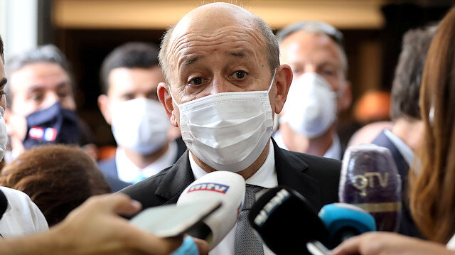 French Foreign Affairs Minister Jean-Yves Le Drian wears a face mask to prevent the spread of the coronavirus disease (COVID-19) as he talks to the media at a school in Mechref, Lebanon July 24, 2020. REUTERS/Mohamed Azakir