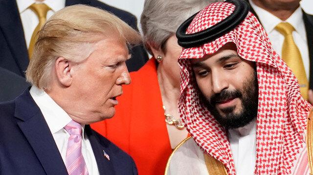 FILE PHOTO: U.S. President Donald Trump speaks with Saudi Arabia's Crown Prince