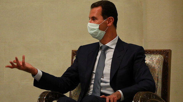 Syria's President Bashar al-Assad wearing a protective face mask