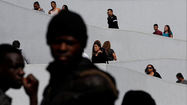 File photo: People wait to apply for asylum in the United States outside the El Chaparral border in Tijuana, Mexico July 19, 2019 REUTERS/Carlos Jasso