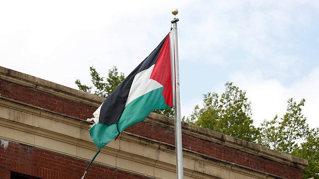 A tattered flag flies over the Palestine Liberation Organization (PLO) office