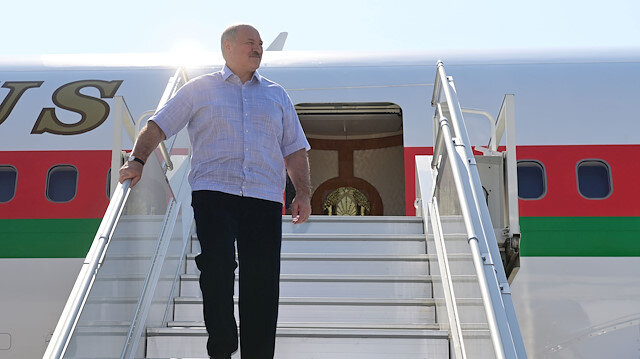 Belarusian President Alexander Lukashenko walks out of a plane upon his arrival at an airport in Sochi, Russia September 14, 2020