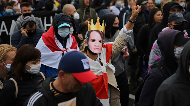 A participant wears a mask depicting Belarusian opposition leader Sviatlana Tsikhanouskaya during a rally to reject the presidential election results and to protest against the inauguration of Belarusian President Alexander Lukashenko in Minsk, Belarus September 27, 2020. Tut.By via REUTERS