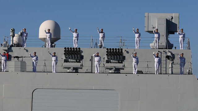 Chinese Navy members wave
