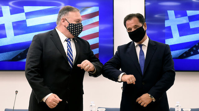 U.S. Secretary of State Mike Pompeo and Greek Minister for Development and Investment Adonis Georgiadis touch elbows during an agreement signing ceremony in Thessaloniki, Greece, September 28, 2020. Giannis Papanikos/Pool via REUTERS