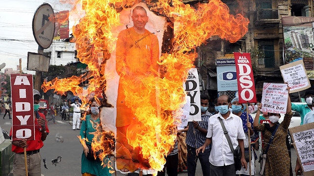 Activists of Socialist Unity Centre of India (SUCI) shout slogans and burn a cut-out of Yogi Adityanath, Chief Minister of the northern state of Uttar Pradesh, during a protest after the death of a rape victim, who was brought from a hospital in Uttar Pradesh to New Delhi's Safdarjung Hospital, where she died while undergoing treatment on Tuesday, in Kolkata, India, September 30, 2020.