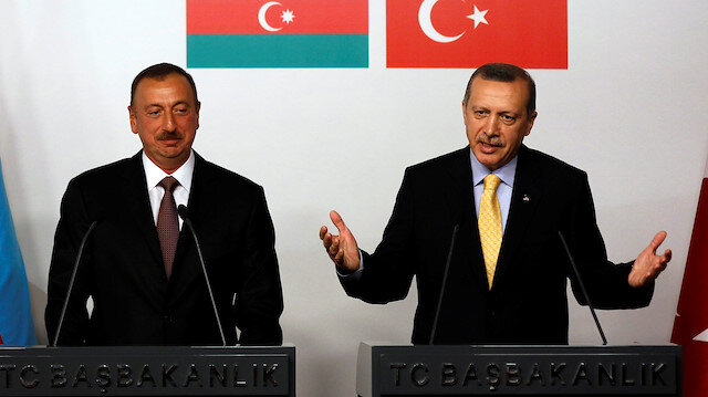 FILE PHOTO: Turkey's Prime Minister Tayyip Erdogan (R) speaks as Azerbaijan's President Ilham Aliyev listens during a news conference following a signing ceremony in Istanbul June 26, 2012. REUTERS/Murad Sezer/File Photo