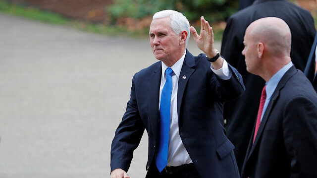 File photo: U.S. Vice President Mike Pence waves to supporters outside the New Hampshire State House as his Chief of Staff Marc Short looks on after Pence filed candidacy papers for President Donald Trump to appear on the 2020 New Hampshire primary election ballot in Concord, New Hampshire, U.S., November 7, 2019