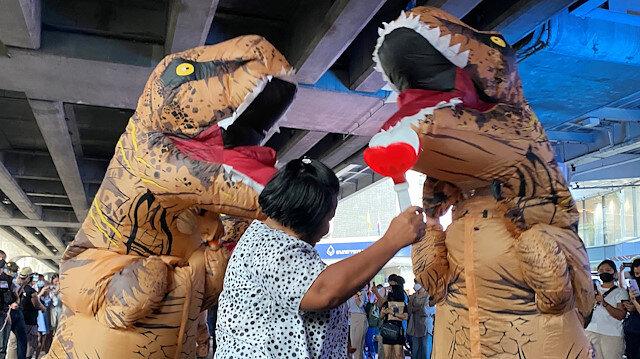 Dinosaur costumed actors representing Thailand's establishment at a high school