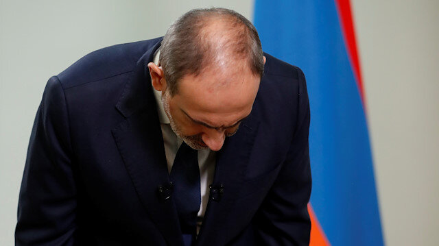 Armenian Prime Minister Nikol Pashinyan bows during his address to the nation in Yereva