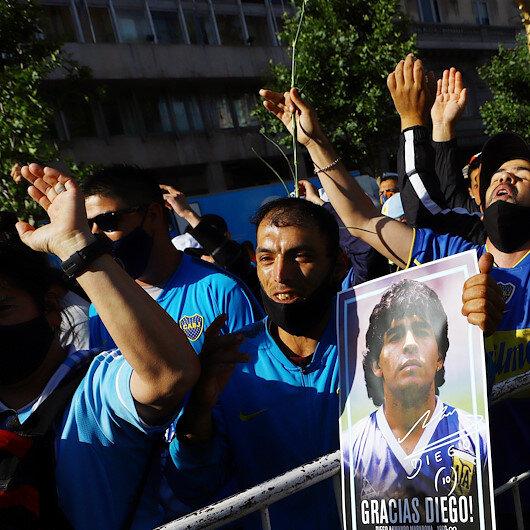 Huge crowds bid farewell to Maradona amid clashes