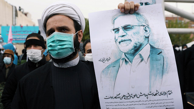 A protester holds a picture of Mohsen Fakhrizadeh