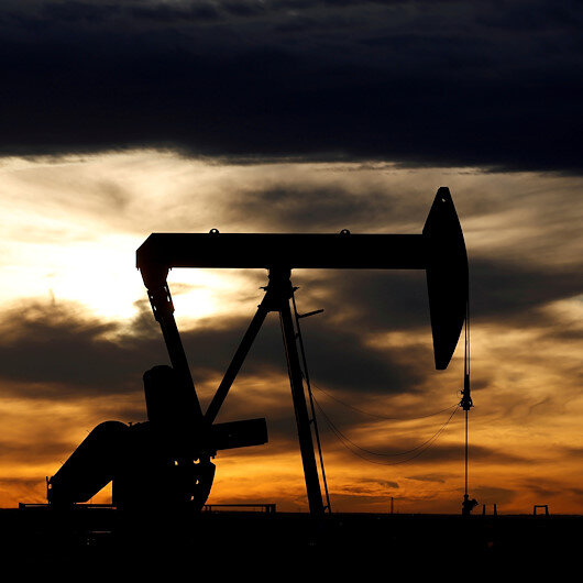 Oil prices down as OPEC delays talks