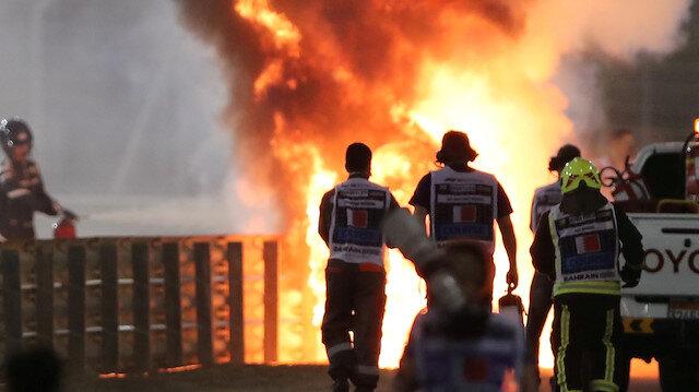 FILE PHOTO: Formula One F1 - Bahrain Grand Prix - Bahrain International Circuit, Sakhir, Bahrain - November 29, 2020 Flames seen from the crash scene after Haas' Romain Grosjean crashed out at the start of the race Pool via REUTERS/Kamran Jebreili/File Photo