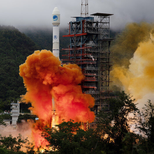 China's new rocket lifts 5 satellites in maiden flight