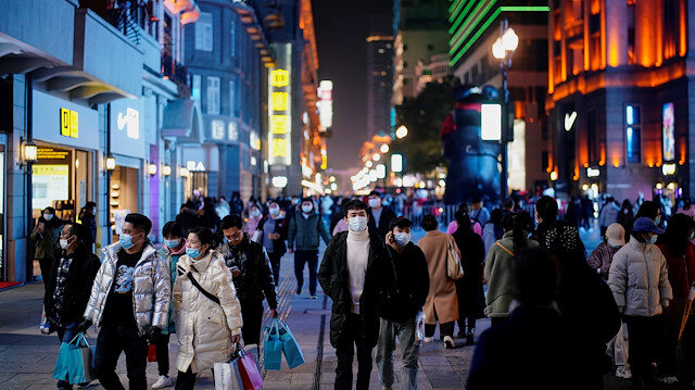 People wearing face masks are seen at a main shopping area almost a year after the global outbreak of the coronavirus disease (COVID-19) in Wuhan, Hubei province, China December 7, 2020. Picture taken December 7, 2020.