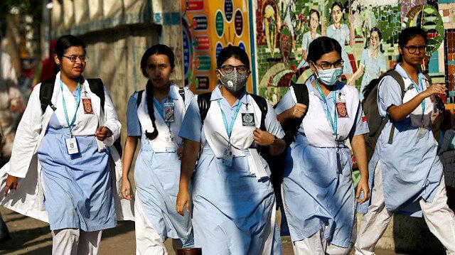 School girls wear masks as a protective measure