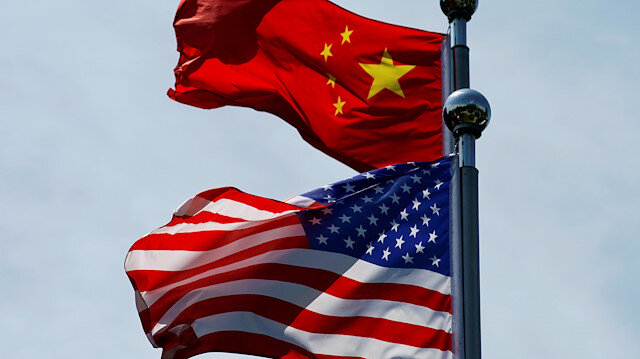 Chinese and U.S. flags flutter near The Bund