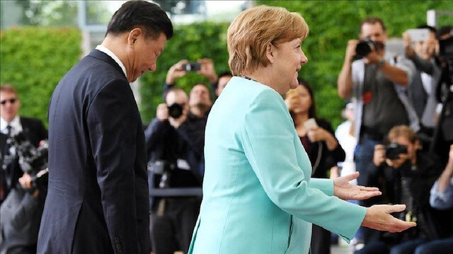 FILE PHOTO - President of People's Republic of China Xi Jinping (L) Chancellor of Germany Angela Merkel (R) in the Chancellery in Berlin, Germany in July 2017. Photo: Maurizio Gambarini - Anadolu Agency