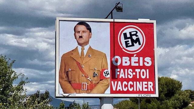 """رغم اعتبارها الرسوم المسيئة للنبي """"حرية تعبير"""".. فرنسا تحقق في لافتات شبهت ماكرون بهتلر"""
