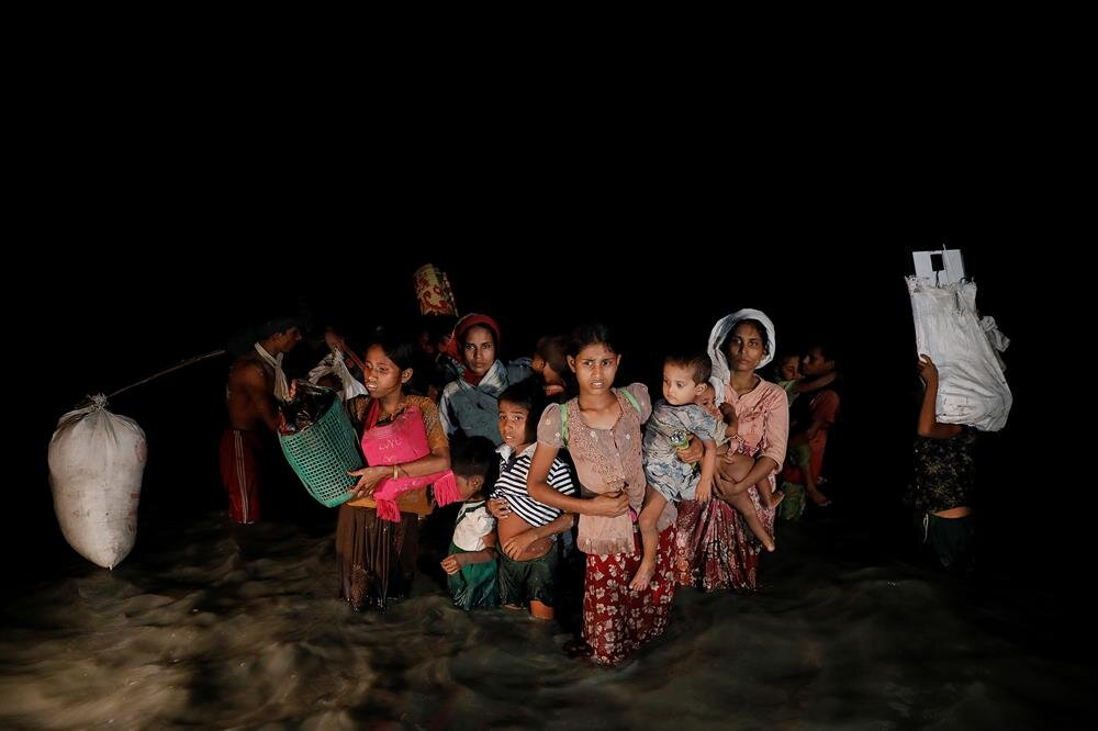 Rohingya travel in the dead of night fearing their lives