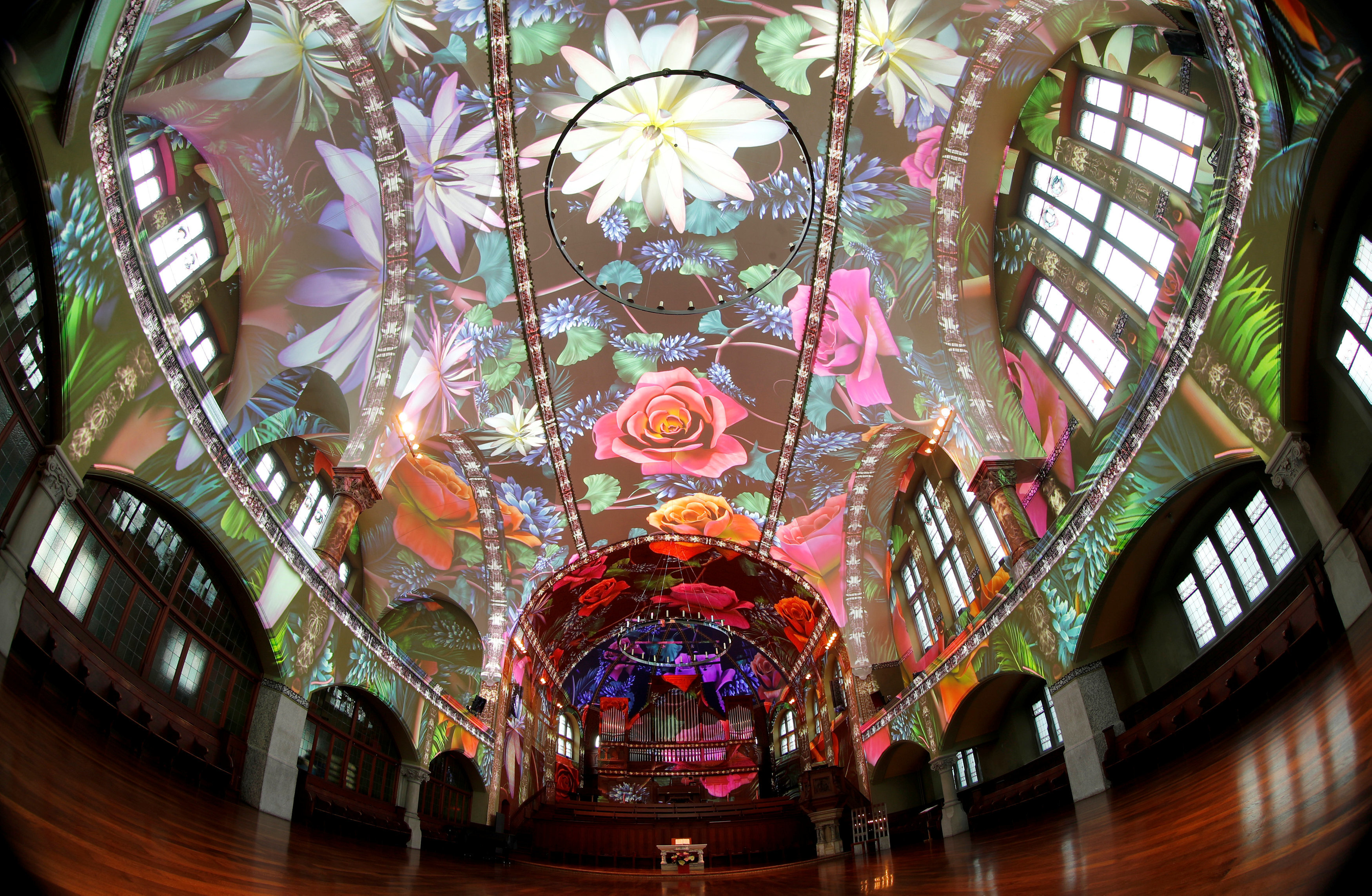 A light projection shows the 'Genesis' multimedia project at the St. Jakob-Kirche in Zurich