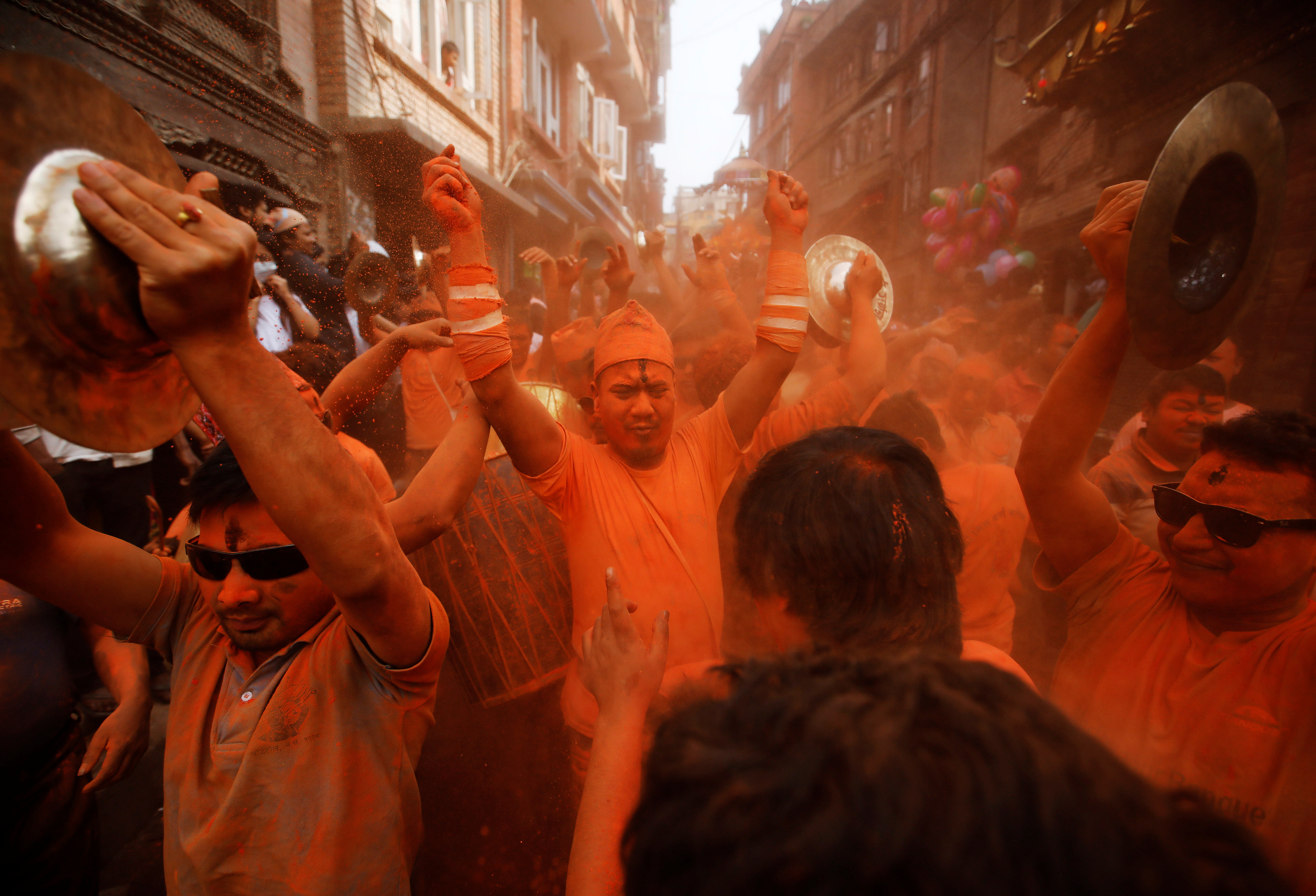 Devotees celebrate 'Sindoor Jatra' vermillion powder festival at Thimi