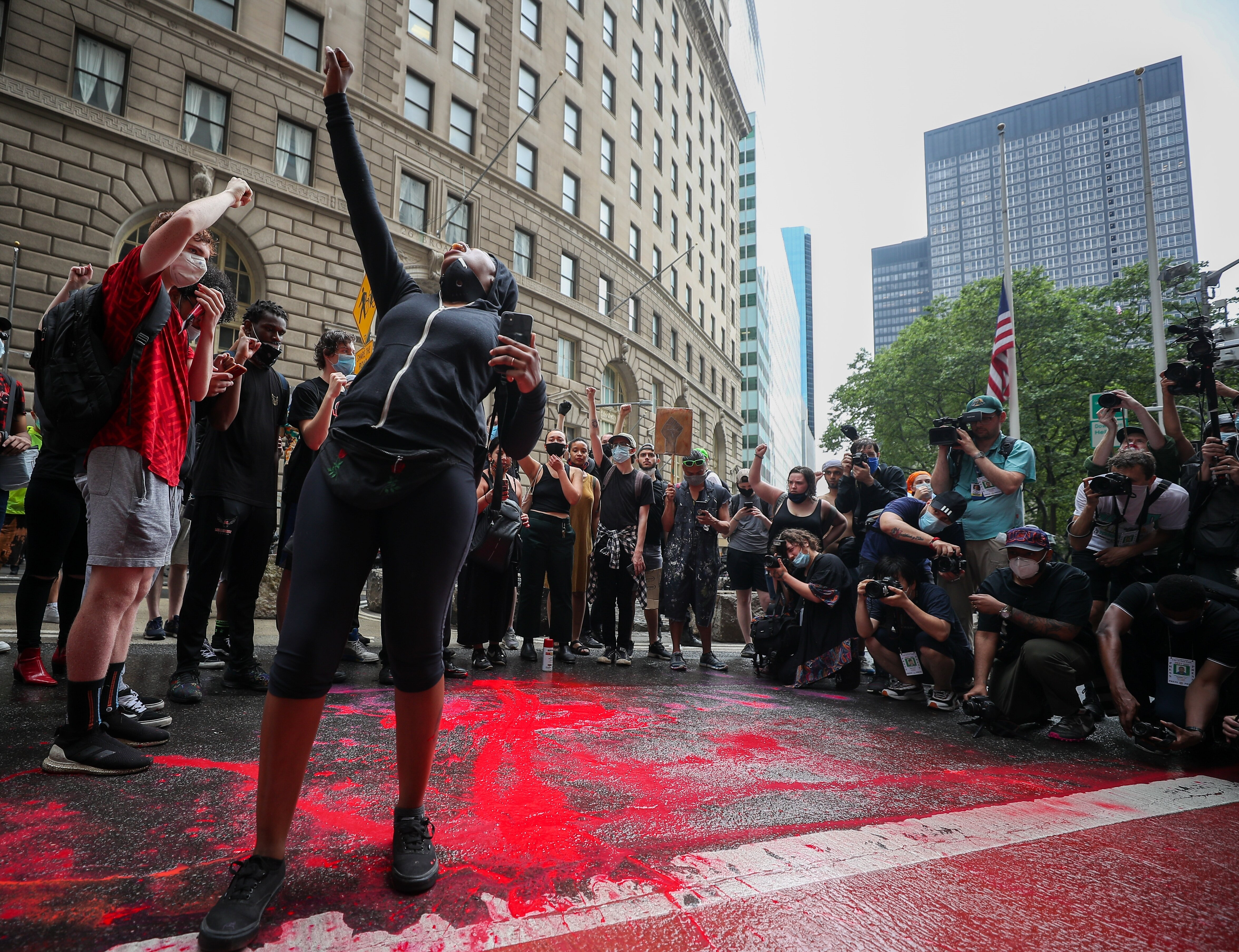 'Black Lives Matter' protestors spill red paint on streets in Financial District in NYC